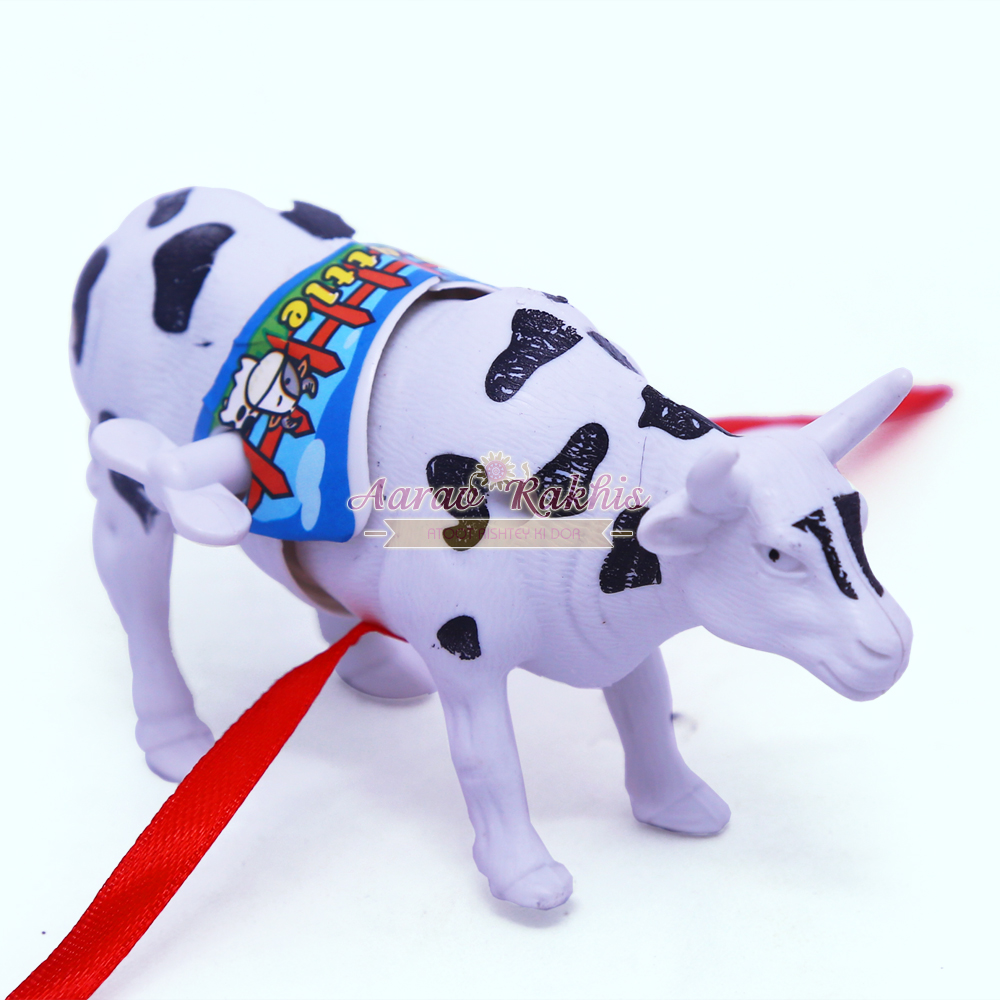 Moving cow toy rakhi gift buy online kids rakhi moving kids rakhi online negle Images