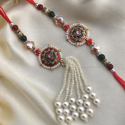 Magnificient Stone & Pearl Beads Bhaiya Bhabhi Rakhi Combo