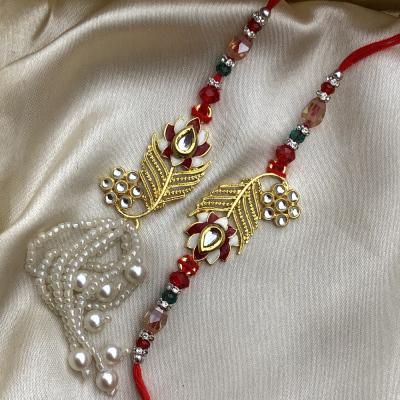 Wonderful Red Stone Gold Designer Bhaiya Bhabhi Rakhi Set