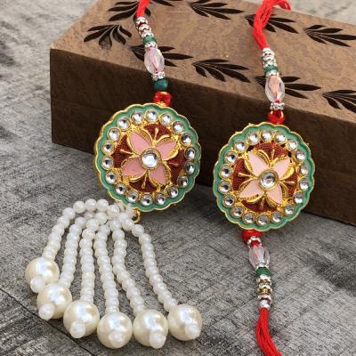 Precious Multicolor Gold Work Bhaiya Bhabhi Rakhi Set