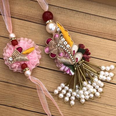Appealing Pink Flower Bhaiya Bhabhi Rakhi Set
