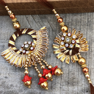Fancy Pom Pom Style Gota Maroon Rakhi for Bhaiya Bhabhi