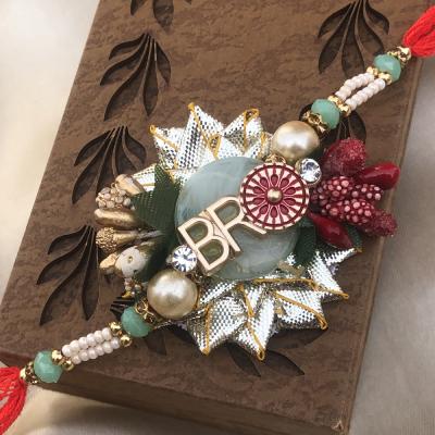 Ravishing BRO Design Green Rakhi for Bhaiya