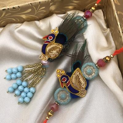 Mesmerizing Peacock Rakhi Set for Bhaiya Bhabhi