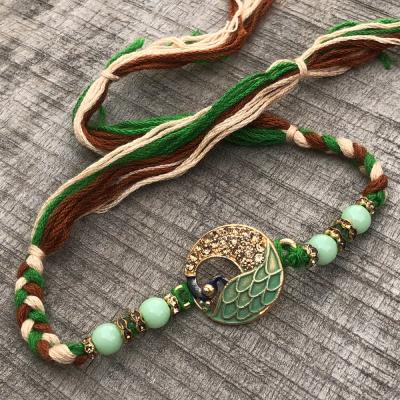 Rare Green Beads & Peacock Gold Rakhi for Brother