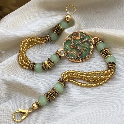 Designer OM Sign Gold Beads Rakhi Set for Brother