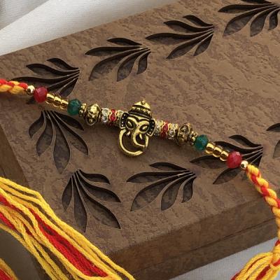 extravagant Beads & Lord Ganesh Rakhi for Brother