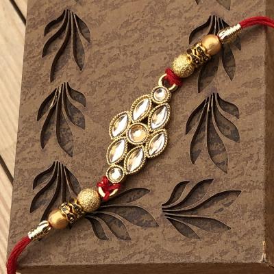 Marvelous Glass Diamond Gold Rakhi for Brother