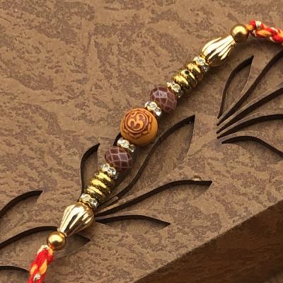 Well Formed Rings & Beads OM Design Rakhi for Brother