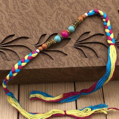 Enthralling Multicolor Pearl Rakhi Set for Bhaiya