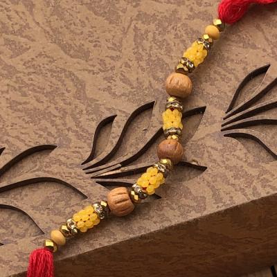 Exquisite Yellow Beads Rakhi Set for Elder Brother