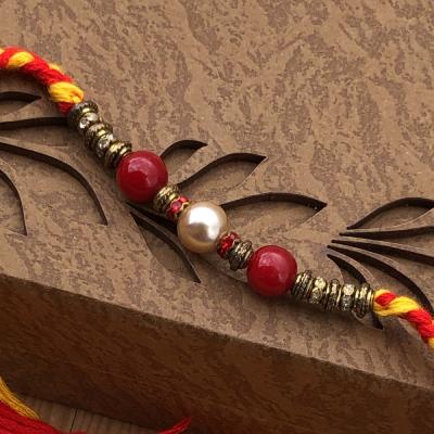 Astonishing Red-Golden Pearl Bhaiya Rakhi Set