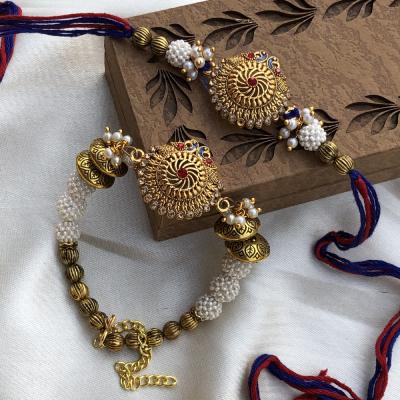 Blooming Peacocks Rakhi Combo Set for Bhaiya Bhabhi