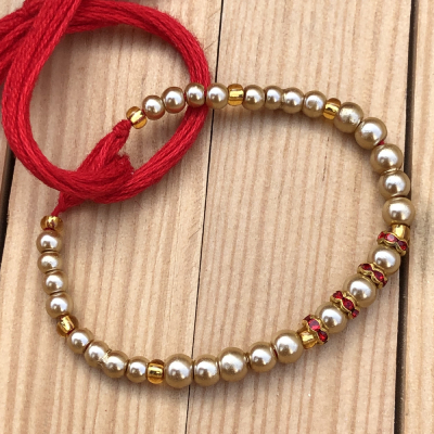 Admirable Gold Plated Pearls Brother Rakhi