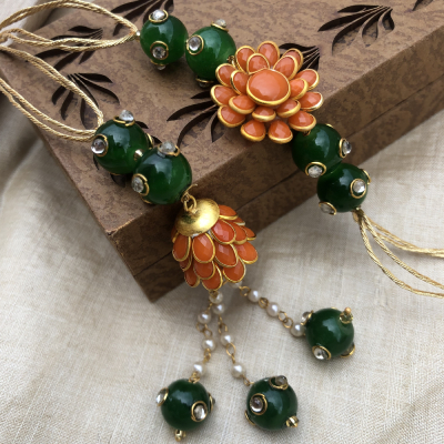 Impressive Orange Floral Pattern with Beads Rakhi Set for Bhaiya Bhabhi