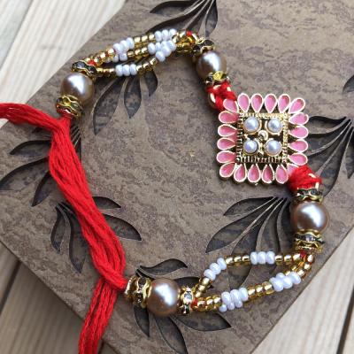 Exclusive Pink Kundan Stone along with Pearls Rakhi for Bhaiya