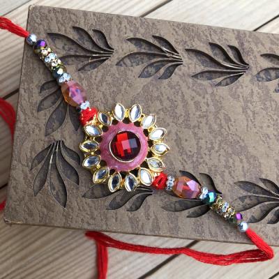 Trendy Red Stone Fancy Kundan Design Rakhi for Brother