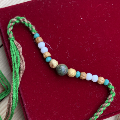 Lovely Beads Look Simple Design Rakhi for Brother