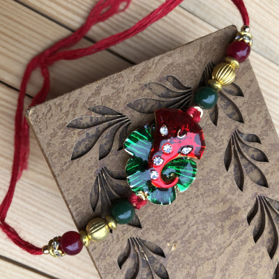 Lucky Lord Ganesha Red-Green Stone Rakhi for Brother